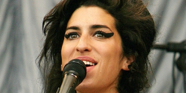 (FILES) In this June 22, 2007 file picture, British pop singer Amy Winehouse performs at the Glastonbury music festival, in Pilton, Somerset, in south-west England.   Winehouse was admitted to hospital after feeling at her home on June 16, 2008 her agent announced. AFP PHOTO/FILES/CARL DE SOUZA (Photo credit should read CARL DE SOUZA/AFP/Getty Images)